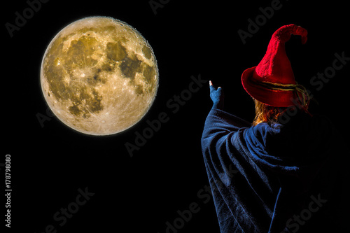 Poster a sorceress points to the full moon at night