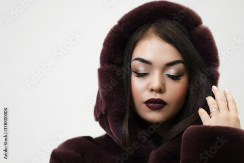 Portrait of Young beautiful Woman in Luxury Fur Coat with copy space for text Poster