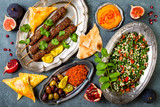 Middle Eastern traditional dinner. Authentic arab cuisine. Meze party food. Top view, flat lay, overhead - 178800404