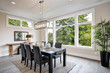 Leinwandbild Motiv Luxurious modern dining room boasts a black dining table