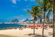 Quadro Copacabana beach (Praia de Copacabana) with palms in Rio de Janeiro. Brazil