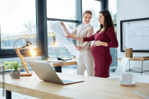 Hardworking designers discussing drafts Poster