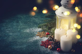 Christmas card with glowing  candle and  lantern on blue background - 178836218