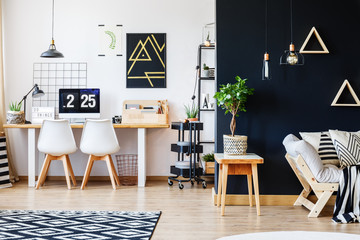 Designer workspace with white chairs