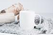 mug,three birch logs and a cozy blanket