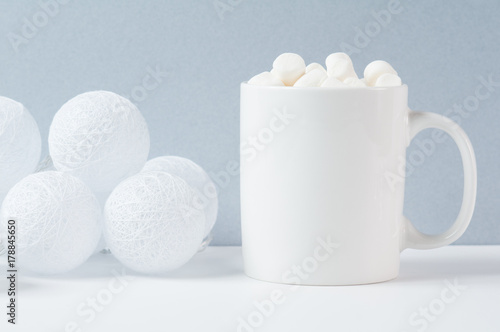 Foto op Canvas Chocolade white mug with marshmallows in a winter scene