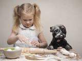 Funny dog and child - cooks. All covered with flour. Fun and interesting - 178850256