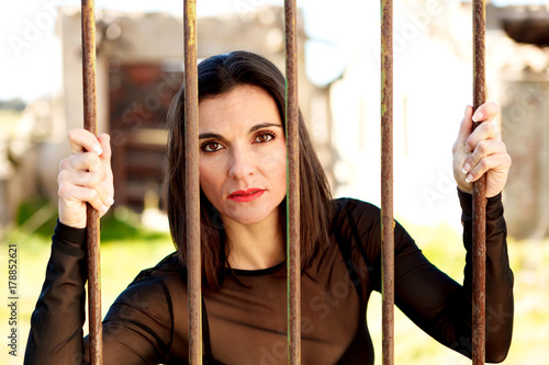 Attractive woman behide the bars Poster