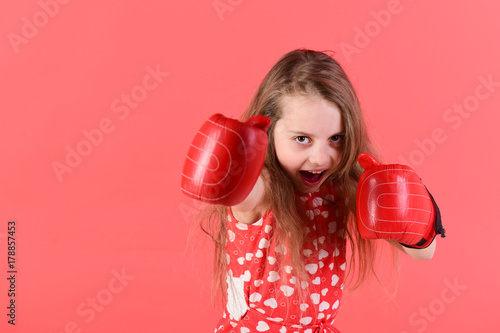 Child boxer with long hair in dress with heart print Poster