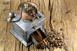 vintage coffee grinder with manufacture roasted Indonesian Arabica coffee beans on rustic wooden background - 178871649
