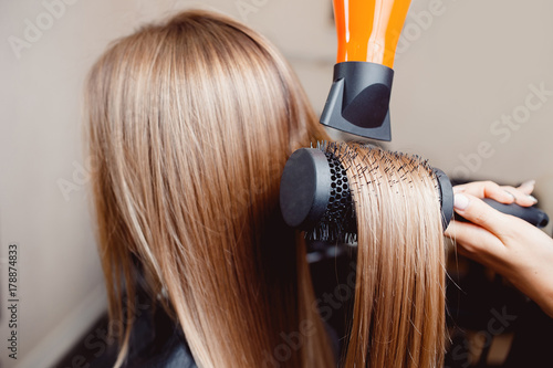 Foto op Canvas Kapsalon Close-up of hair dryer for hair drying, concept hair salon, female stylist.