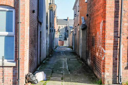 A back 'entry' (alleyway) between the rear of houses in Belfast.