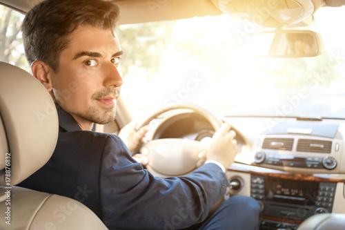 Foto op Aluminium Nacht snelweg Young businessman driving a car