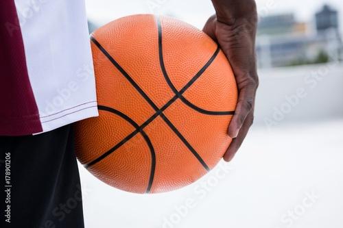 Fotobehang Basketbal Player holding basketball