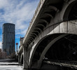 A view of the Bow Tower and Calgary Tower from under the center street bridge