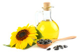 Sunflower oil in glass jug, seeds and flower isolated on white background