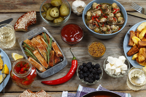 Fotobehang Hot chili peppers Dinner table. Various vegetarian snacks. View from above, rustic style