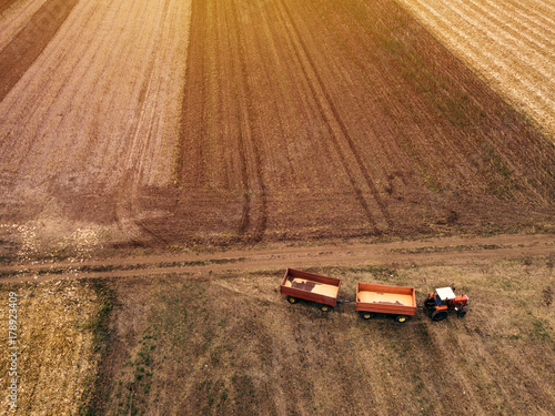 Fotobehang Trekker Aerial view of agricultural tractor in the field