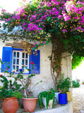 traditional street with bright bougainvillea in Greece - 178933609