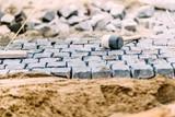 Fototapety Pavement rocks, granite cobblestone blocks - details of path, road or sidewalk construction