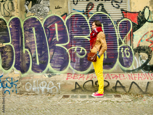 Foto op Canvas Graffiti Woman in yellow pants at the grafitti wall (2)