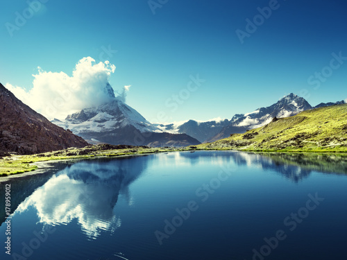 Wall mural Reflection of Matterhorn in lake Riffelsee, Zermatt, Switzerland