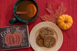 Ginger snaps and hot apple cider for a cozy autumn snack - 178974825