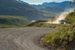 Tour bus driving on gravel road in Denali National Park, Alaska