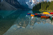 A row of canoes sitting in the evening sun, ready to be taken on the water. Louise lake in Banff national park, Alberta, Canada