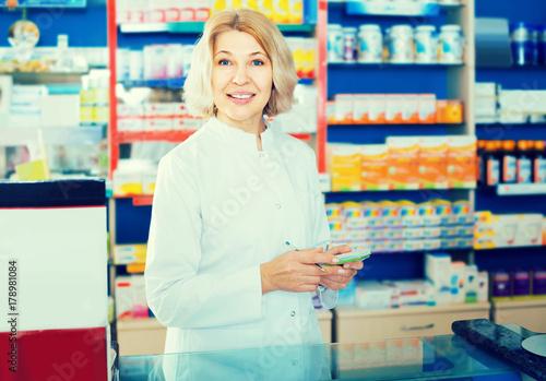 Fotobehang Apotheek female pharmacist posing in drugstore