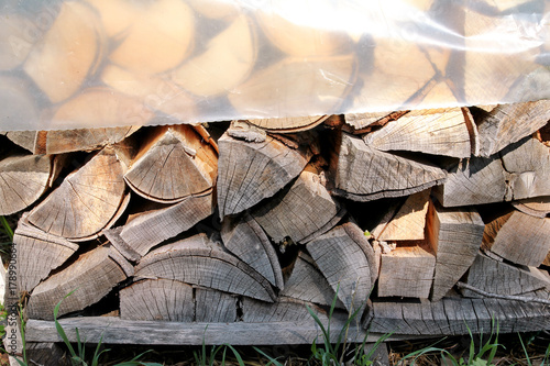 Foto op Plexiglas Brandhout textuur Cut wood, firewood for the winter. Cut logs fire wood and ready pieces of wood for heating wood. Lumber industry. Heating season, winter season. Renewable resource of energy. Environmental concept.