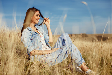Young woman enjoying a sunny day in the meadow