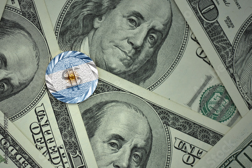 Papiers peints Buenos Aires coin with dollar sign with national flag of argentina on the dollar money banknotes background