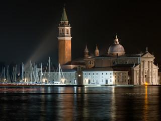 Night view of San Giorgio Maggiore across the lagoon, Venice, Italy.