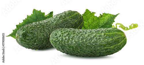 Fotobehang Verse groenten Fresh cucumbers with leafs isolated on white background with clipping path