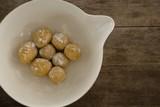 Round dough balls kept in a bowl - 179023273