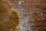 Flattened dough on a wooden table - 179023689