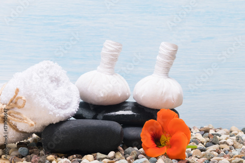set of things for Thai massage and spa procedures on a blue background