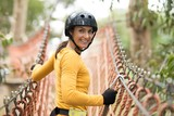 Woman walking on the rope bridge