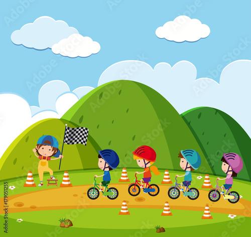 Fotobehang Lime groen Kids racing bike in the park