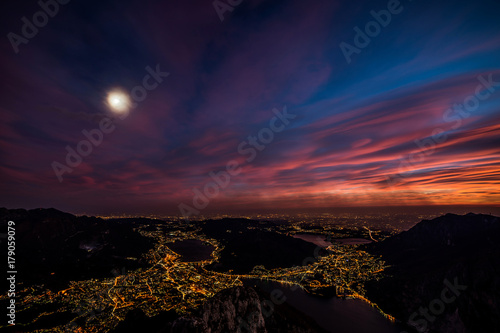 panoramic view to Lecco city by night from above - Lake Como district Lombardy Italy