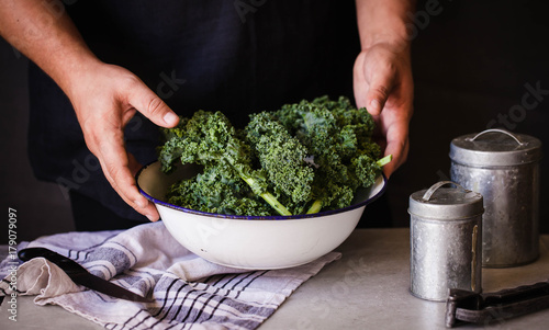 Kale cabbage green salad preparation process hands - 179079097