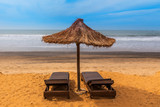 West africa Gambia - chairs and umbrellas on a paradise beach