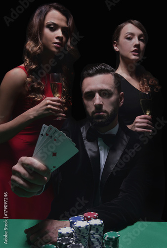 Poster concentrated men and women playing poker in casino