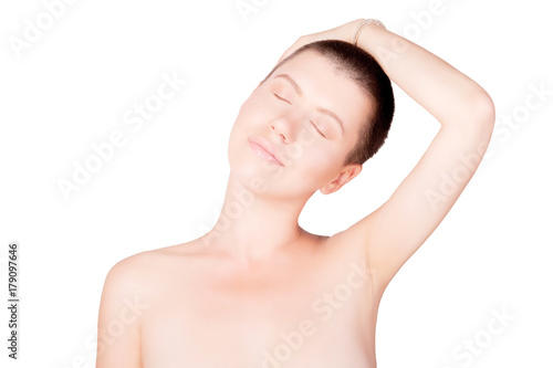 Portrait of positive woman with bald haircut with bare shoulders on isolated whi Poster