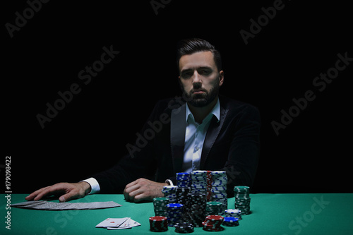 Player at the Poker table. плакат