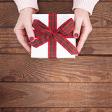 Present. Gift box. Woman holding small gift box with ribbon. - 179115002