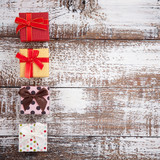 Presents on wooden background close up. Small gift boxes with ribbon top view mock up square. - 179115068