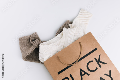 clothes in shopping bag