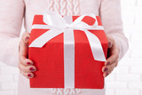 Present. Gift box. Woman holding small gift box with ribbon. - 179119007